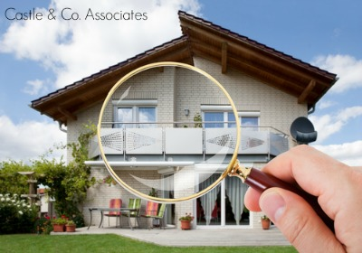 Magnifying glass looking at house